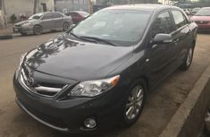 Grey/silver 2012 Toyota Corolla car automatic at attractive price in Lagos