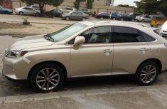 Tokunbo clean Lexus RX 2015 350 FWD Gold
