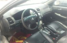 Neat Nigerian used Honda Accord 2005 Sedan LX Automatic Silver
