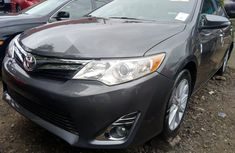 Sell well kept grey/silver 2014 Toyota Camry automatic at mileage 0