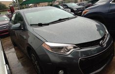 Certified blue 2014 Toyota Corolla automatic in good condition