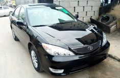 Sell well kept black 2005 Toyota Camry sedan automatic in Lagos