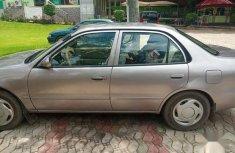 Neat Nigerian used Toyota Corolla 2001 Sedan Gold