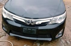 Sell well kept black 2015 Toyota Camry automatic in Lagos