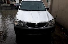 Clean used grey/silver 2002 Mazda Tribute suv / crossover automatic for sale in Lagos