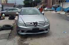 Sell well kept grey/silver 2009 Mercedes-Benz C350 sedan at price ₦4,100,000