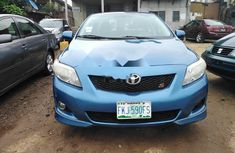 Sell used blue 2009 Toyota Corolla sedan automatic at cheap price