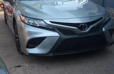 Sell grey/silver 2018 Toyota Camry automatic at price ₦16,000,000