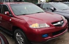 Need to sell red 2006 Acura MDX at price ₦2,100,000 in Lagos