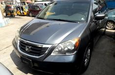 Need to sell cheap used grey/silver 2010 Honda Odyssey van / minibus in Lagos