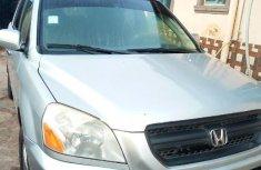 Neat Nigerian used Honda Pilot 2004 EX 4x4 (3.5L 6cyl 5A) Silver