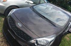 Well maintained brown 2015 Kia Rio sedan manual for sale