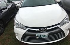 Well maintained white 2015 Toyota Camry sedan for sale in Abuja