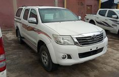 Sell cheap white 2014 Toyota Hilux automatic in Lagos