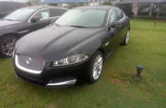 Selling black 2012 Jaguar XF automatic in good condition in Lagos