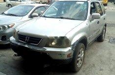 Selling grey/silver 1999 Honda CR-V automatic in Lagos