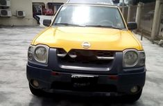 Selling yellow 2002 Nissan Xterra automatic in good condition in Lagos