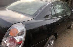Clean and neat used black 2003 Nissan Altima automatic in Lagos at cheap price