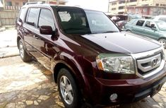 Selling red 2009 Honda Pilot automatic at price ₦3,900,000 in Lagos