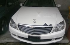 White 2011 Mercedes-Benz C300 car at attractive price in Lagos