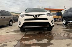 Clean and neat used white 2016 Toyota RAV4 automatic in Lagos at cheap price