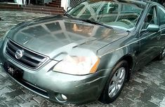 Very sharp neat green 2003 Nissan Altima for sale in Abuja