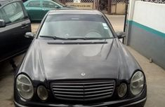 Need to sell black 2002 Mercedes-Benz E320 sedan at price ₦1,024,358