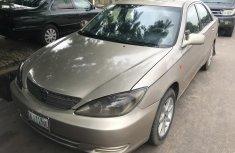 Gold 2004 Toyota Camry car sedan automatic in Lagos