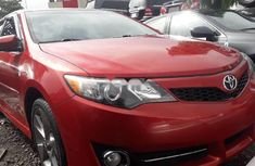 Clean and neat used red 2014 Toyota Camry automatic in Lagos at cheap price