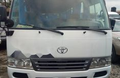 Clean and neat white 2012 Toyota Coaster van / minibus at price ₦12,500,000 in Lagos