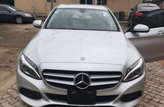 Selling grey/silver 2015 Mercedes-Benz C200 automatic at price ₦12,600,000