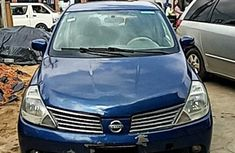 Need to sell cheap used blue 2008 Nissan Tiida hatchback in Lagos