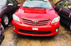 Foreign Used Toyota Corolla Automatic 2010 Red Lagos