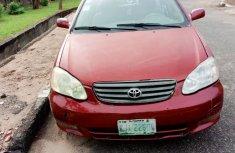 Red Nigerian Used  Toyota Corolla 2003 Model  for Sale in Ishaga