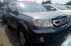 Clean Tokunbo Honda Pilot Grey 2010 Model