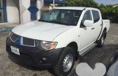 Neat Nigerian used Mitsubishi L200 2009 White