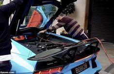 Moment an ₦134m electric blue Lamborghini Aventador gets a jump-start from passing motorist