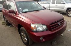 Foreign Used 2006 Maroon Toyota Highlander for sale in Lagos.