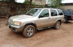 Locally Used 2000 Gold Nissan Pathfinder for sale in Lagos.