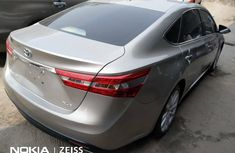 Foreign Used 2014 Gold Toyota Avalon for sale in Lagos
