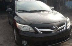 Tincan clear2011 Toyota Corolla color black LE