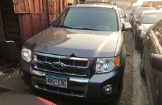 Foreign Used 2010 Dark Grey Ford Escape for sale in Lagos.