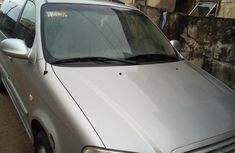A neatly used 2004 Kia Carnival with factory fitted A/C in perfect condition for sale