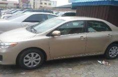 Naija Used 2011 Gold Toyota Corolla for sale in Lagos