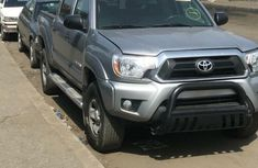 Foreign Used 2014 Silver Toyota Tacoma for sale in Lagos.