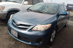 Foreign Used 2013 Blue Toyota Corolla for sale in Lagos.