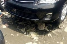 Foreign Used 2013 Black Toyota Corolla for sale in Lagos.