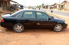 Foreign Used 2002 Black Toyota Avalon for sale in Lagos.