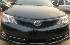 Foreign Used 2012 Black Toyota Camry for sale in Abuja.
