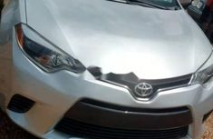 Foreign Used 2015 Silver Toyota Corolla for sale in Abuja.